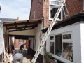 Ladders used to access roof in order to install a new flue