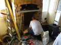 Stone hearth cut to shape and installed